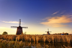 Relics From A Golden Age (Alfred Grupstra) Tags: windmill netherlands nature sky dutchculture ruralscene sunset landscape polder traditionalwindmill windturbine summer mill field agriculture wind blue old outdoors schermerhorn 799