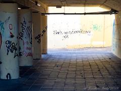 Is She?_B120404 (Jonathan Irwin Photography) Tags: is she graffiti under pass subway shadows danger fuerteventura canaty island spain olympus omd emi mkii 1240mm lens
