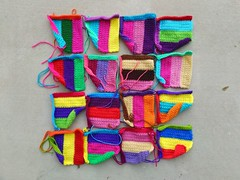 Sixteen rehabbed television test strip crochet squares in need of finishing work (crochetbug13) Tags: crochet crocheted crocheting crochetsquares crochetremnants crochetrectangles crochetblanket projectamigo