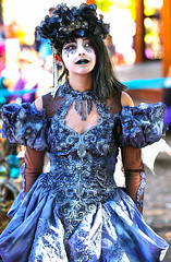 Dark Fairy Emerges From An Explosion Of Color (wyojones) Tags: texas texasrenaissancefestival toddmission texasrenfest renfest renfaire renaissancefaire faire renaissancefestival festival trf beauty girl woman fairy beautiful pretty lovely gorgeous cute brunette blueeyes dress hat collar facepaint blacklips