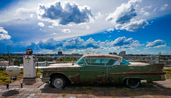 Cadillac (MAKER Photography) Tags: cadillac petrol station gas grill clouds sky blue white car wheel window crane skyline fence stones grass