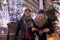 Female friends enjoying shopping in Christmas (Apricot Cafe) Tags: ap2a8129 asia asianandindianethnicities christmas christmastree japan japaneseethnicity minatoward roppongi sigma35mmf14dghsmart tokyojapan capitalcities carefree casualclothing christmasdecoration christmaslights citylife citystreet coatgarment colorimage consumerism enjoyment friendship happiness illuminated laughing leisureactivity lifestyles night onlywomen outdoors people photography realpeople scarf shopping shoppingbag smartphone smiling togetherness toothysmile twopeople winter women youngadult