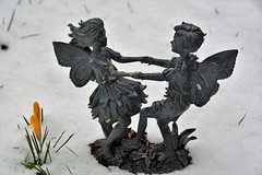 Playing in the Snow (suekelly52) Tags: fairy snow crocus flower garden ornament