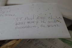An old piece of mail collects dirt in the abandoned St. Paul's AME Church.