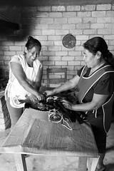 Desplumando el pavo (Marcos Núñez Núñez) Tags: streetphotography documentary documentaryphotography blackandwhite bw ethnic mx oaxaca yolox blancoynegro canon canoneosrebelt5 chinantecos chinantla méxico byn