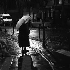 By the roadside (pascalcolin1) Tags: paris13 femme woman pluie rain reflets reflection lumière light parapluie umbrella nuit night route road bord roadside photoderue streetview urbanarte noiretblanc blackandwhite photopascalcolin 50mm canon50mm canon