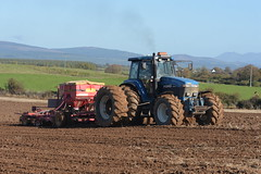 Ford 8770 Tractor with a Vaderstad Rapid Seed Drill (Shane Casey CK25) Tags: ford 8770 tractor vaderstad rapid seed drill winter barley traktor traktori tracteur trekker trator ciągnik new holland newholland cnh nh blue casenewholland sow sowing set setting drilling tillage till tilling plant planting crop crops cereal cereals county cork ireland irish farm farmer farming agri agriculture contractor field ground soil dirt earth dust work working horse power horsepower hp pull pulling machine machinery grow growing nikon d7200 mallow