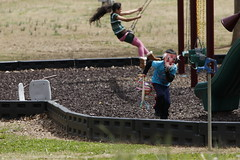 Angel Hervert Gonzales, 5, runs from the swingset wearing an old man mask. Gonzales is one of the youngest members of Abila's dance group.
