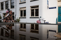 Bicycle reflections @ Amsterdam (PaulHoo) Tags: fuji fujifilm fujifilmx70 candid streetphotography people amsterdam city urban citylife cycling bicycle reflection building exterior cityscape girl woman