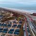 Blick von oben über Ferienpark Qurios in Bloemendaal mit angrenzendem Strand