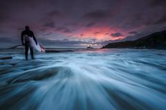 Surfer Dude (ianbrodie1) Tags: stmarys old hartley sunrise longexposure nikon water sea seascape clouds rocks surfer surfboard coast coastline sky cliffs tyneside lighthouse