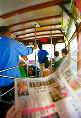 Hong Kong tram newspaper commute perspective (Martin Breschinski) Tags: blur colour colourful constructor fast hongkong image martinbreschinski motion newspaper personal perspective photographer pov reportage rich tram transport travel travelogue