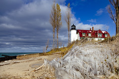 Ice at Betsie (Notkalvin) Tags: michigan benziecounty pointbetsie lighthouse shore ice icicles winter beacon lakemichigan outdoors horizontal building red redrooflake water beach sand frozen