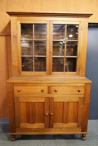 Antique walnut 12 pane step back cupboard ($504.00)