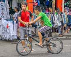 Just do it (Beegee49) Tags: street bicycle boys young men cycling market just do it sony a6000 skylum talking bacolod happy planet happyplanet city philippines asia