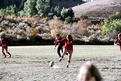 71-897 (ndpa / s. lundeen, archivist) Tags: nick dewolf nickdewolf color photographbynickdewolf 1975 1970s film 35mm 71 reel71 summer fall aspen colorado september ruggerfest aspenruggerfest 8thannual eighthannual rugby tournament women womensrugby woman youngwoman youngwomen player players jersey jerseys uniform uniforms girl girls game playing field rugbyfield ball kick kicking valley roaringforkvalley building house home