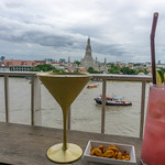 Cocktails and Peanuts with a View of Wat Arun Temple in Bangkok thumbnail