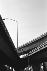 San Jose (bior) Tags: sanjose freeway overpass underpass concrete pavement asphalt blackandwhite bw monochrome gray highway siliconvalley santaclaracounty santaclaravalley kodakfilm kodak tmax100 iso100 kodaktmax kodaktmax100 tmax ef50mmf12lusm 50l canoneoselaniie elaniie elan 35mmfilm film filmphotography filmslr 50mm canonef50mmf12lusm