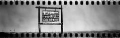 False advertising (No Stone Unturned Photography) Tags: roadside sign colorado welcome black white monochrome kodak folding expired ilford delta 100 35mm film sprocket holes jiffy camera art deco 1933 six16 616 panoramic