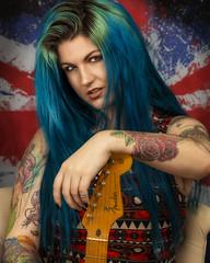 That's Rock'n'Roll (brianjdavies) Tags: studioportrait rockchick guitar fenderstratocaster glamour eyes hair bluehair attitude tattoos