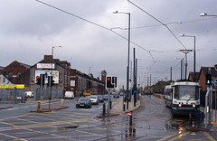 Manchester, Eccles New Road (peter.velthoen) Tags: 1901and1949 manchestercorporationtramways tramway manchester weaste ecclesnewroad metrolink manchestermetrolink film slide scan dia rain regen road sky intersection
