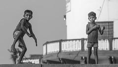 The Kite Runner (ybiberman) Tags: varanasi india utterpradesh gaiaghat boy people streetphotography candid kite blowing string dancing smiling barefoot flipflops bw