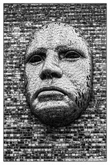 The face (Photography And All That) Tags: face frown sculpture lincoln wall bricks brickwork mask masks line lines pattern patterns texture textures faces frowns frowning serious sculptures walls sony sonyalpha7mark3 sonyalpha sonyilce7m3 ilce7m3 blackwhite blackandwhite monochrome monochromatic monochromes man male human expression expressions