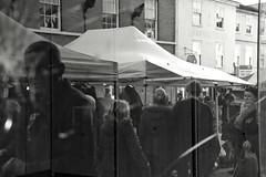 Reflections on Life (Bury Gardener) Tags: bw blackandwhite monochrome mono burystedmunds britain 2018 nikond7200 nikon england eastanglia people peoplewatching folks suffolk streetphotography street streetcandids snaps strangers candid candids buttermarket