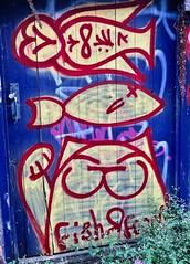 Cat and Fish, Brighton, UK (Robby Virus) Tags: brighton england uk unitedkingdom britain greatbritain gb street art graffiti cat kitty paw wave waving raised owl fish food