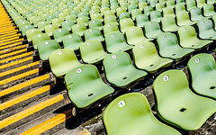 Cheese & Grapes - Explored (DobingDesign) Tags: abstract lines seating pattern munich münchen deutschland germany rows columns yellow green olympiastadion olympiapark seats stadium shadow shapes colour linesandgeometrics stairs steps stripes geometric linedup diagonal numbers
