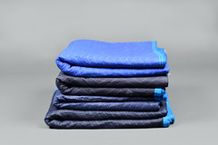 Pile of Four Black and Blue Folded Moving Blankets (hireahelper) Tags: furniture blanket moving pad mover relocate black blue grey shadow backdrop fabric pile