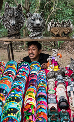 Souvenir Guy - Chichén Itzá - Yucatán, Mexico (ChrisGoldNY) Tags: friendlychallenges chichenitza mexico yucatan mexican souvenirs salesman colors colorful colours colourful latinamerica painter paint mustache people candid men latin latino forsale licensing challengewinners chrisgoldphoto chrisgoldny chrisgoldberg funny humor moment sonyalpha sonya7rii sonyimages bookcover albumcover postcards posters life warmth alive greetingcards repetition