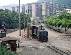 Yuejing Sichuan  |  2011 (keithwilde152) Tags: zl147 yuejing jiayang coal railway sichuan china 2011 town landscape park tracks crossing people passenger train electric locomotives outdoor summer