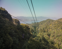 View at the island from the rope way to mount Misen (fnks) Tags: asia japan tokyo hiroshima miyajima island sea trees ropeway shrines buddhism temples ferry sky deer beach tides tanterns water sunshine mountains