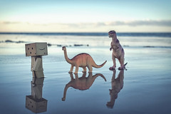 The Ascent of Robot. (Matt_Briston) Tags: danbo robot dinosaurs sheringham beach sand wet reflection fuji x70 matt cooper flickrfriday split