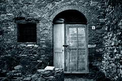 Creepy door (A_Raven_) Tags: old creepy monochrome monochromatic door tuscany italy toscana monocromatico wall campiglia porta architecture architectural architettura