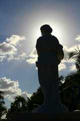 In Her Glory (Julianne Baker) Tags: statue sun shining shadow silhouette white sky blue resort dominican republic bahia principe palm trees afternoon