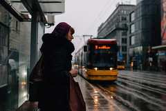 Portrait of a Woman waiting for the tram. (ewitsoe) Tags: city nikon street warszawa winter erikwitsoe erikwitsoecom poland urban warsaw lady woman portrait nikond80 35mm cityscape snow weather wet tram tramlife station travel pedestrain pedestrian