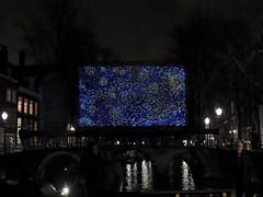 Starry night on a cloudy evening (Shahrazad26) Tags: amsterdamlightfestival20182019 amsterdam noordholland nederland holland thenetherlands paysbas vincentvangogh starrynight nightshot nachtopname