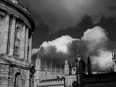 Winter Light on Oxford (cycle.nut66) Tags: blackandwhite monochrome grayscale olympus epl1 evolt micro four thirds mzuiko oxford clear bright winter light sky hertford college radcliffe camera clouds white grey stonework old university buildings