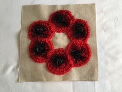 Poppies for Remembrance. (Pat ann 44) Tags: handcrafts valeofglamorgan rememberthem remembrance lestweforget southwales llantwitmajor wallhanging poppysquares poppies