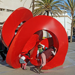 Art is where the fun of play is - Cadiz, Spain (TravelsWithDan) Tags: children sculpture artinpublicplaces red artword playing cadiz spain europe city urban candid canong16