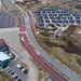 Luftaufnahme Ferienpark Qurios in Bloemendaal aan Zee, Niederlande mit Parkplätzen und Straße