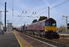 GBRf Loco 66743 in Belmond Royal Scotsman livery races through Manningtree with the Hams Hall - Felixstowe North Intermodal service 18 01 2019 (pnb511) Tags: gbrf class66 intermodal container freight greateasternmainline geml electric overhead cable ohc catenary traction loco locomotive diesel station platform track blue sky
