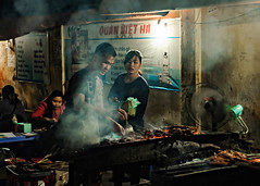 Cooking Chicken Feet With A Fan (mrmeezoid) Tags: streetfood street food urban people vietnam hanoi travel asia man cook skewers chicken feet meat barbeque night streetphotography fan cool cool2 cool3 uncool uncool2 uncool3 cool4 cool5 uncool4 cool6 uncool5 cool7 c7u5 iceboxcool