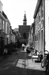 Haarlem street view - Kerkstraat (lumpy79) Tags: pentax me smc pentaxm 1750mm forte 200 expired 2004 shot iso 6419° 2015 developped haarlem holland hollandia netherlands bibe blackandwhite feketefehér crnobijeli film analog epsonv500