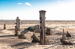 SPURN HEAD BEACH & SKY DEFENCES, E YORKSHIRE_DSC_2510_LR_2.5 (Roger Perriss) Tags: kilnsea spurn d750 beach spurnhead spurnpoint posts sea seadefences weathering rocks sky shadows bluesky