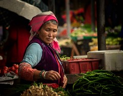 Bai Woman Shopping (Rod Waddington) Tags: china chinese bai minority ethnic ethnicity shopping vegetables market portrait woman traditional indoor