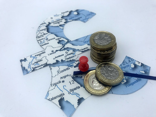 A map of a country cut into a pound sign with a pin in it and GBP pounds to represent Offshore Tax Havens
