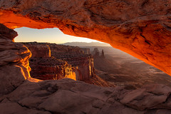 Warm Mesa Arch Sunlight (NickSouvall) Tags: mesa arch canyonlands national park moab utah southwest red orange rocks rock formation canyon vista spire la sal mountains mountain range morning daybreak sunrise sunlight warm light glow frame landscape nature photography photo photographer